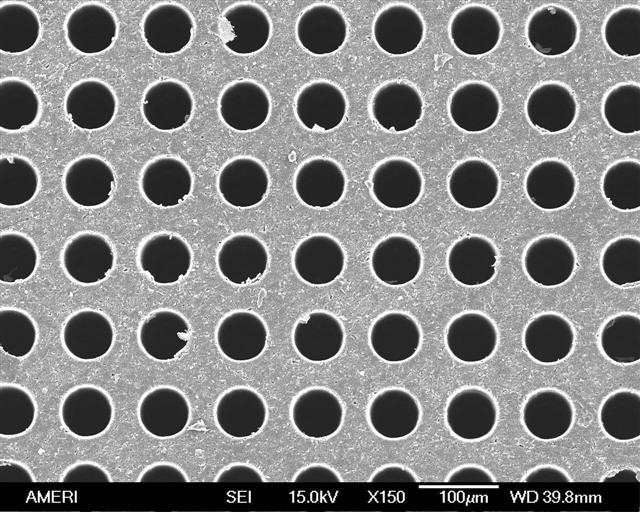 Top view of drilled polyimide wafer